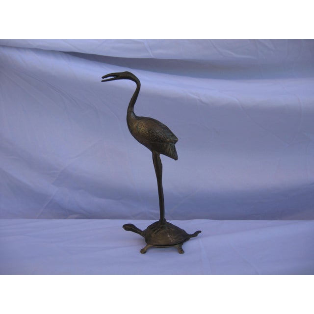 Lovely vintage brass crane perched on a turtle symbolizes longevity and power, based off of the ancient Japanese version.