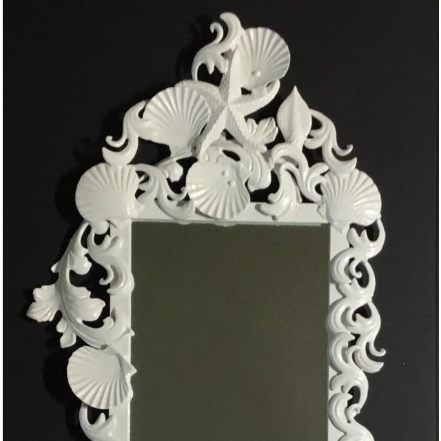 Exceptional mirror made of iron, artistically decorated with seashell and sea star motifs, painted with white lacquer...