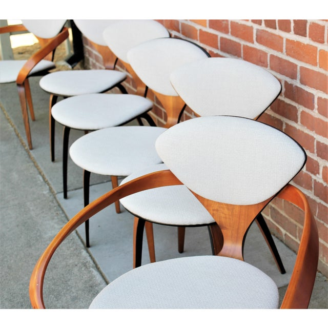 Set of six molded plywood dining chairs by Norman Cherner for Plycraft. Designed in 1958, the Cherner chair is an icon of...