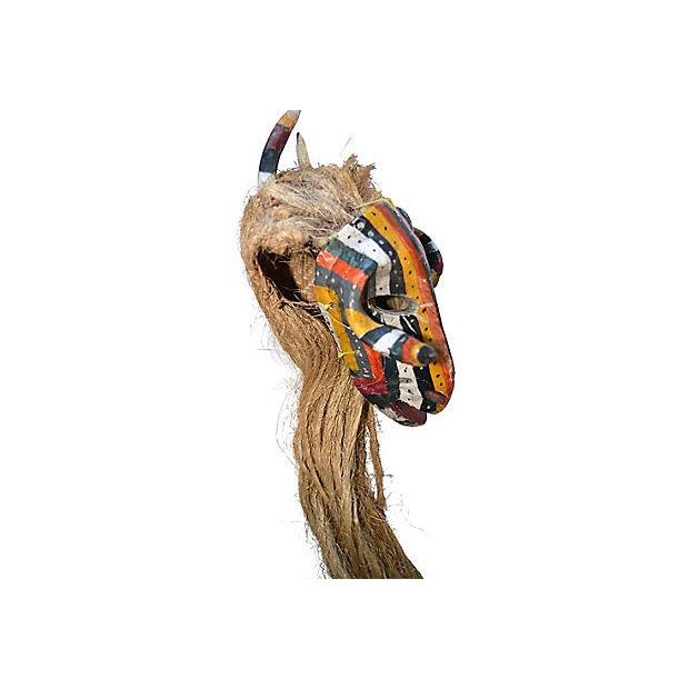 Mexican hand-carved and hand-painted wood ceremonial goat mask with agave fiber hair made by the Tlapaneco people. Dates...