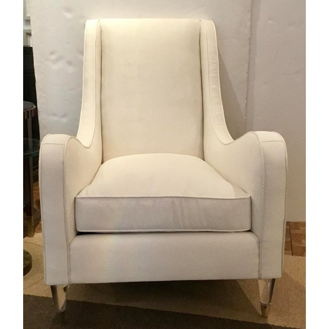 Stylish Caracole Modern White Just Wing it Club Chair Prototype, white geometric fabric, acrylic legs with polished nickel...