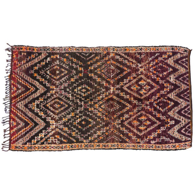20090 Vintage Beni M'Guild Moroccan Rug with Tribal Style, Berber Moroccan Rug. Bursting of variegated colors from...