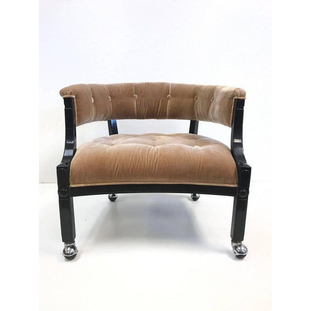 Hollywood Regency slipper chair. Tufted in velvet has a black lacquered frame with casters.