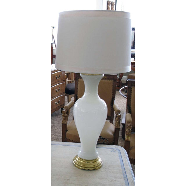 An elegant French 1960's white opaline baluster-form glass lamp; the gracefully shaped lamp of milky translucent glass...