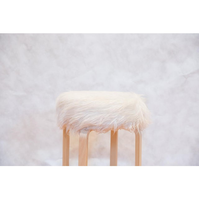 :: An Alvar Aalto style base stool with a white faux fur top. Perfect for an armoire or desk. This unique piece is hand...