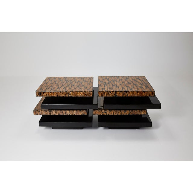 Contemporary lacquered coffee table comprised of stacked rectangular forms, alternating between plain black gloss and...