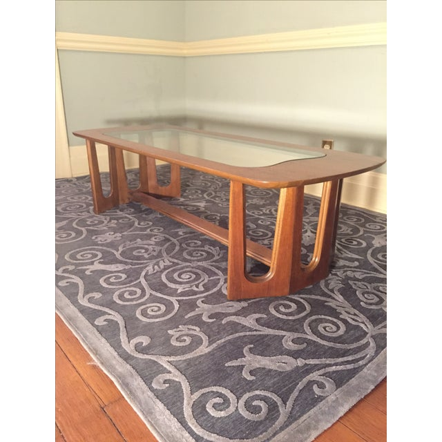 Great glass coffee table by Bassett Furniture Company. Has some small chips in veneer on top. Over all good condition.