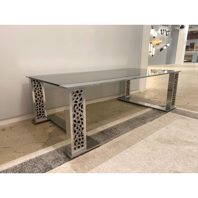 A rare original 1970s handmade burnt and hammered aluminum and smoked glass table by Belgian goldsmith, Willy Luyckx for...