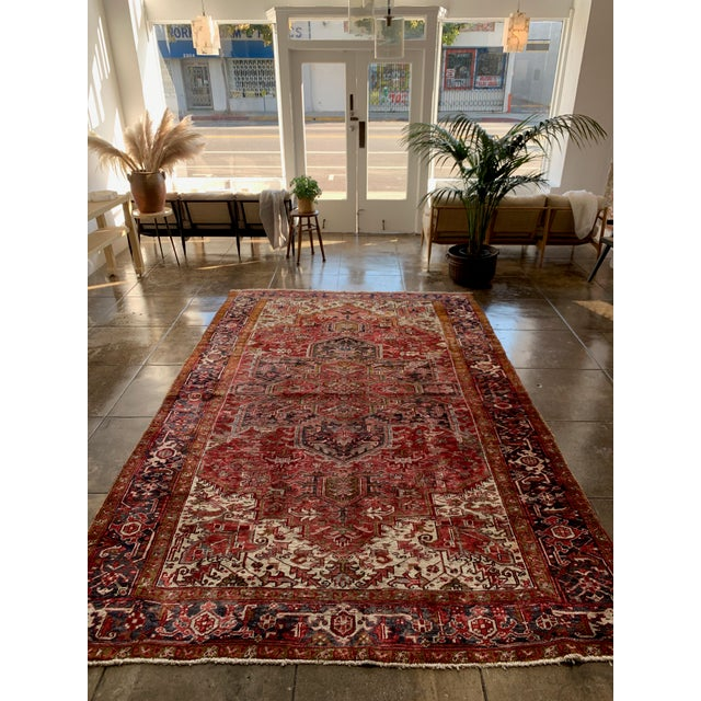 "This vintage Persian Heriz rug, made in the 1940s, has bold red tones. Ties together any room. 11' 10"" x 7'4"""