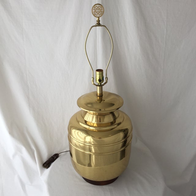 A beautiful vintage brass lamp with a ginger jar shape, wooden base, and Asian motif finial. A fabulous statement lamp...