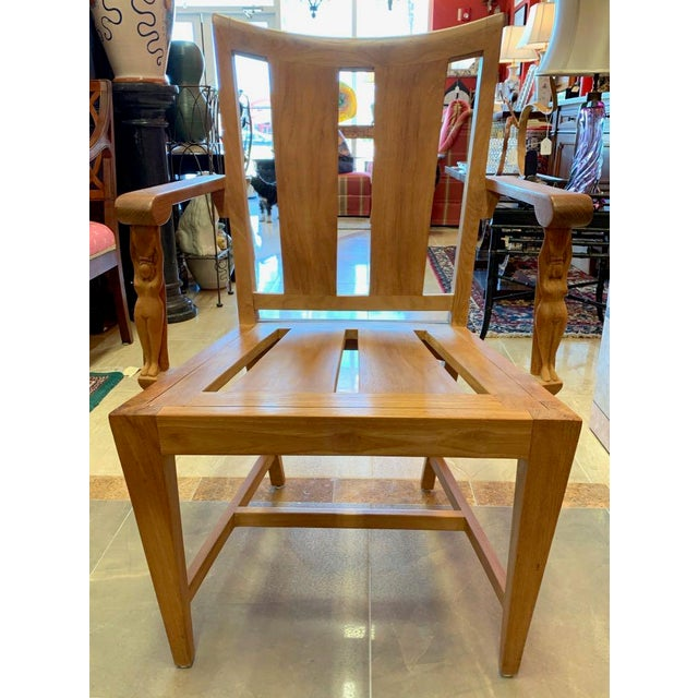 Sutherland's Matisse dining chairs These otherwise plain, straight, chair feature a caryatid supporting the arm. The full...