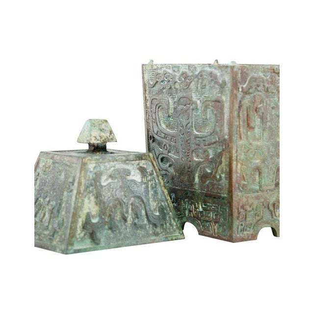 Patinated verdigris bronze square vessel with peaked lid inspired by ancient Chinese Fangyi form wine boxes designed by...
