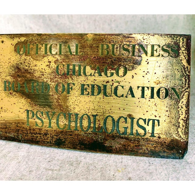 This weathered brass sign officially identifies a City of Chicago Board of Education psychologist. The aged patina...