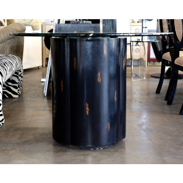 An unusual metal and wood glass top table with a McGuire brass label. The top we put on as we acquired just the base. The...