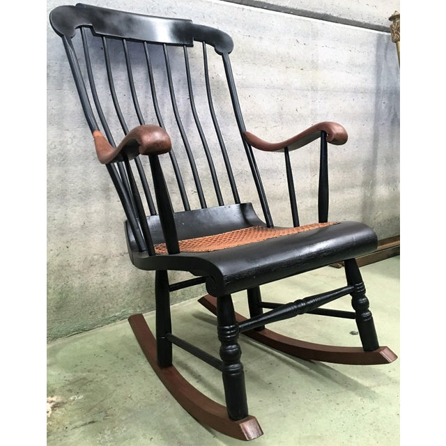19th Hitchcock rocking chair with woven seat and black painted.