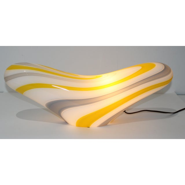 This stylish biomorphic form table lamp in yellow, soft gray and white was created in the 1970s by Seguso Vetri d'Arte....