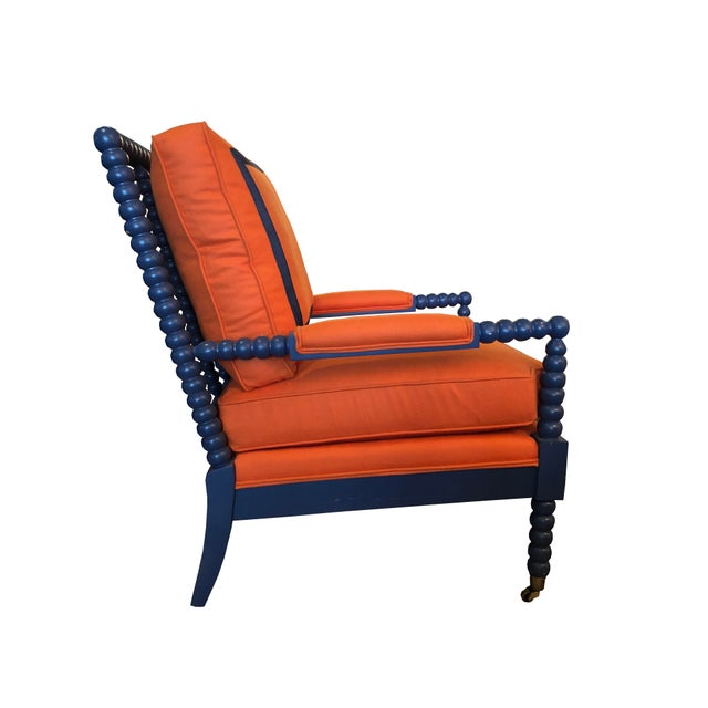 CR Laine Spool Chair Chair. Upholstered in CR Laine Sheer Genius Tangerine Felt (100% Wool) with Framed Navy Band Back...