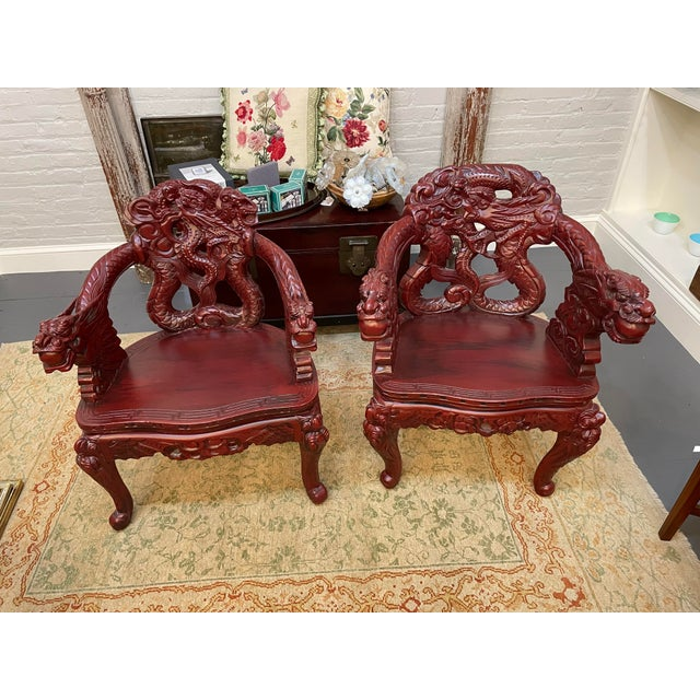 These are a pair of Chinese Dragon Chairs. They are mid-century from the 1960s. The chairs are carved wood with beautiful...