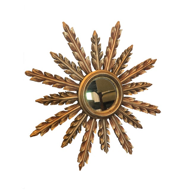 A large and fabulous vintage mid century giltwood starburst mirror from France.