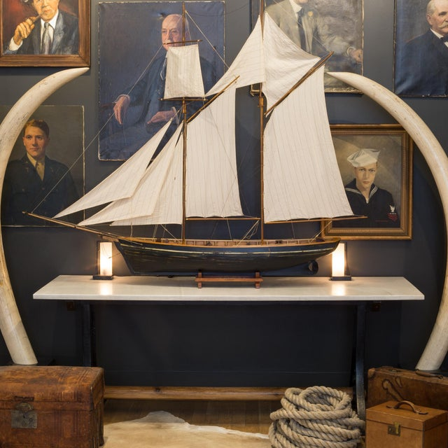 ABOUT This is an original large wooden ship model with original fabric sails and masts. Brass accents are on the tips of...