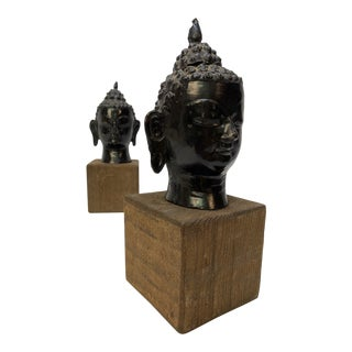 Pair of Decorative Cast Buddha Heads For Sale