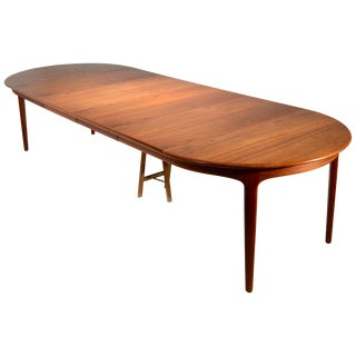 Extra Long Danish Teak Round Table With 4 Extensions by Henning Kjaernulf For Sale