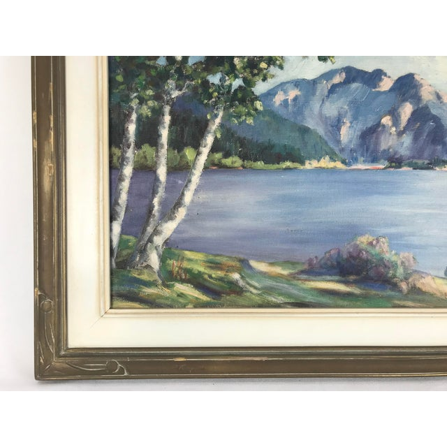 Mid-century framed oil painting of a brightly colored mountainous landscape and body of water. Strong purple tones run...