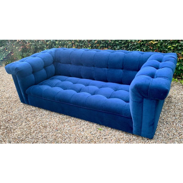 Iconic Dunbar party sofa in cerulean tufted blue velvet, designed by Edward Wormley. Large enough for a wonderful...