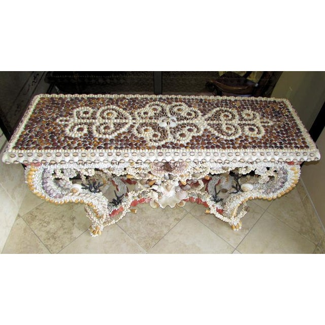 A showroom display model - French Louis XV natural seashell encrusted console table. A stunning creation of natural shells...