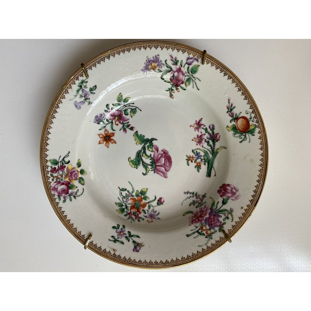 A set of six deep Familie Rose plates, decorated in enamel colours and gold with flowers. 18th century. Diam. 9 inches. (6)