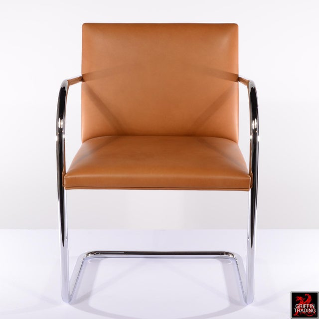 Set of six Mies van der Rohe Brno armchairs in leather by Knoll International. These classic chairs were created by the...