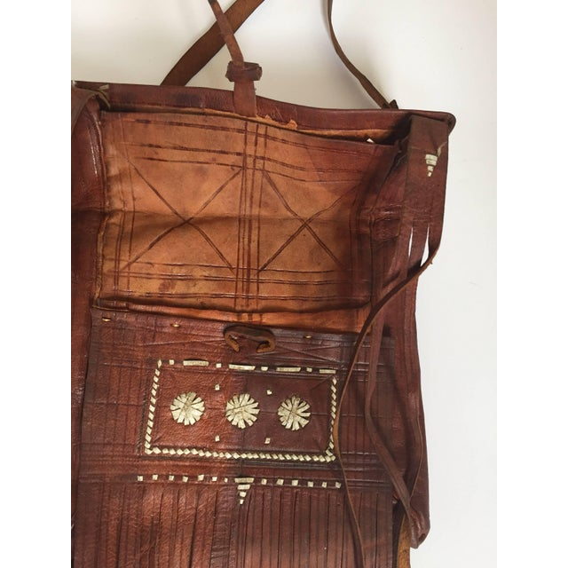 Vintage African Moroccan leather handcrafted tuareg bag with fringes. Real work of art hand made by the Berber tribes of...