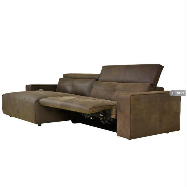 The Davis Recliner Sectional is upholstered in top grain leather and has a patented motion feature that gives the sofa...