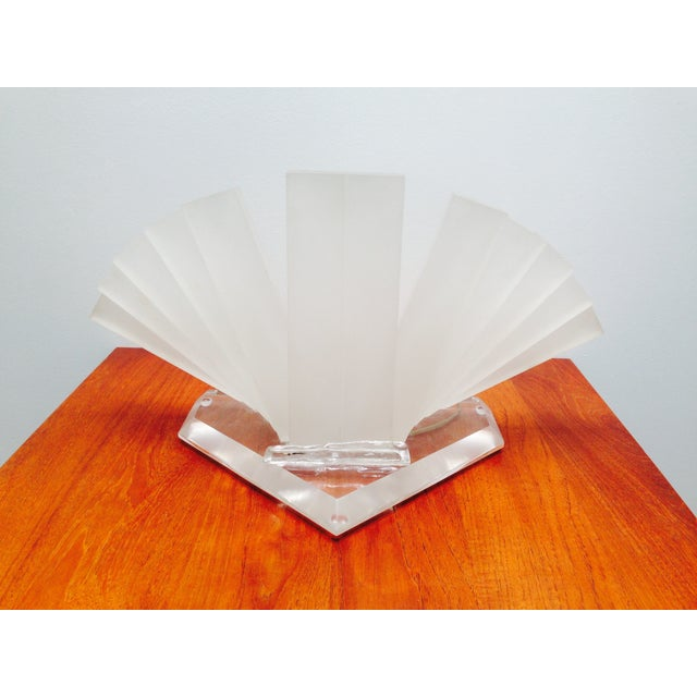 This is a very unusual decorative lucite table lamp that is just as much a sculpture as it is a lamp. It's constructed of...