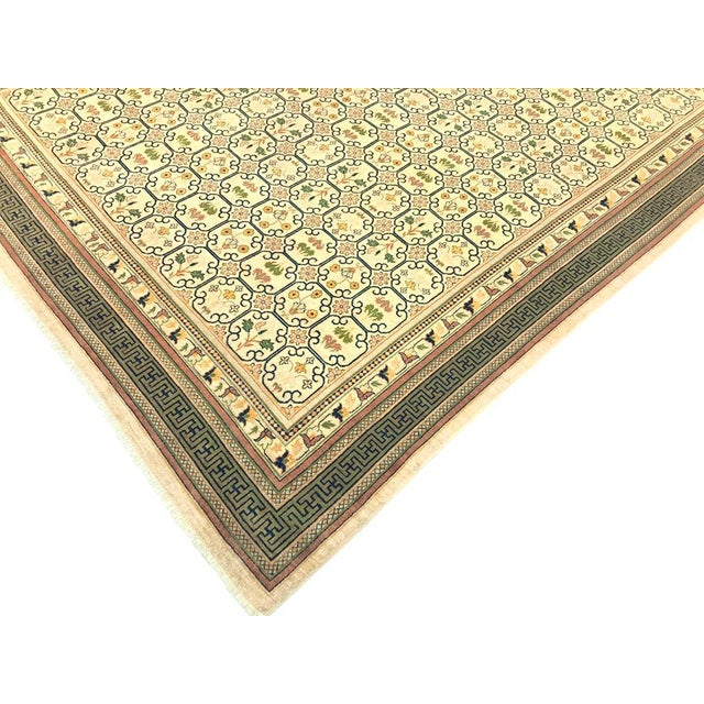An elegant modern hand knotted ivory tan rug will blend into any style of décor. Neutral background with crisp vivid...
