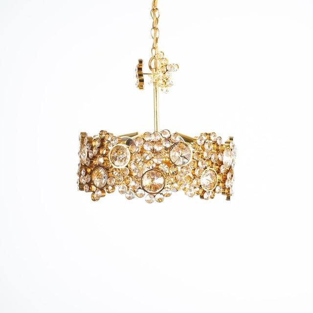 Palwa Crystal glass gold-plated brass chandelier refurbished lamp, circa 1965. This lamp was handcrafted and executed with...