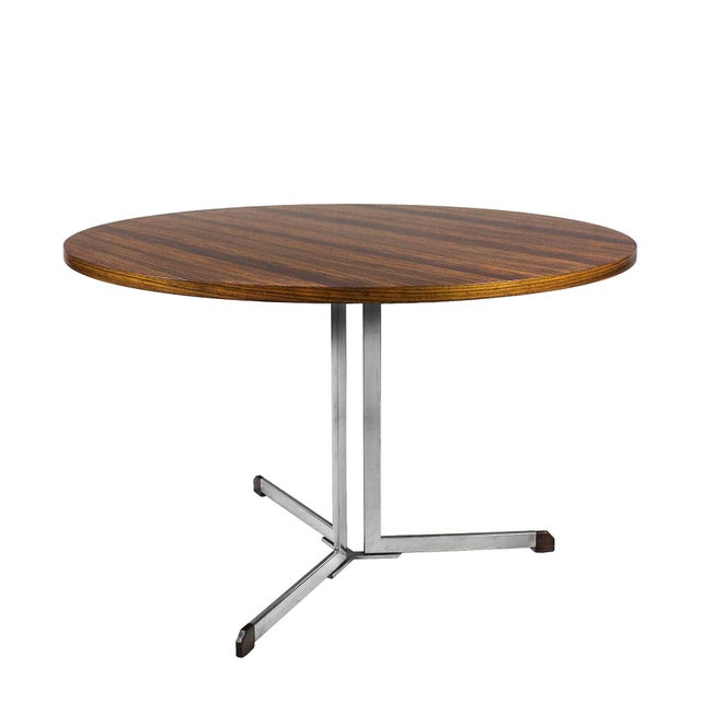 Round table, nickel plated steel stand with solid zebra wood feet, solid wood top with zebra wood veneer, satiny...