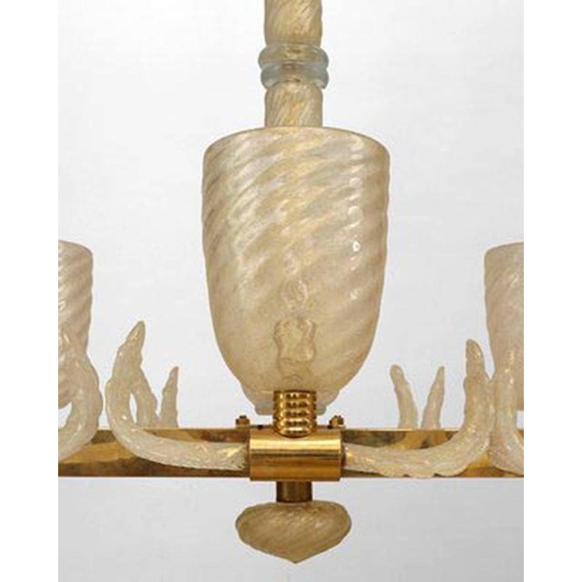 """Two Modern Italian Murano gold dusted """"Pulegoso"""" bubbled glass and brass chandelier of rectangular form with ten swirl..."""