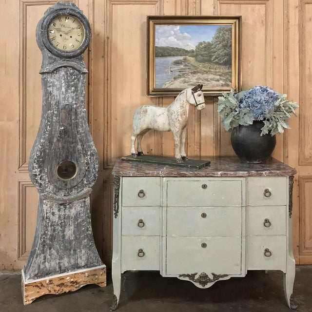 19th Century French Louis XVI Painted Marble Top Commode features tailored neoclassical lines, with a lovely antique...