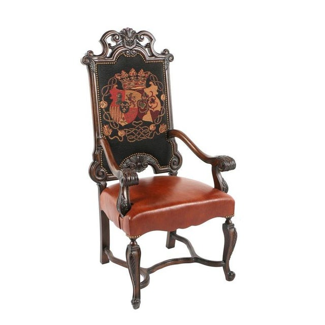 A vintage Louis XIV style armchair. This chair features a shaped crest rail with carved shell cartouche over an...