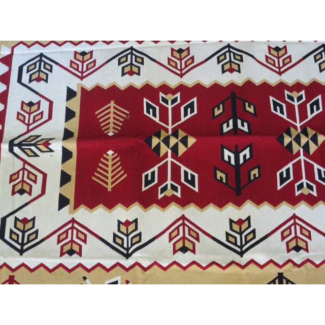 This woven Turkish rug is the perfect accent piece to any living space. Its Navajo style, that feels both tribal and folk...