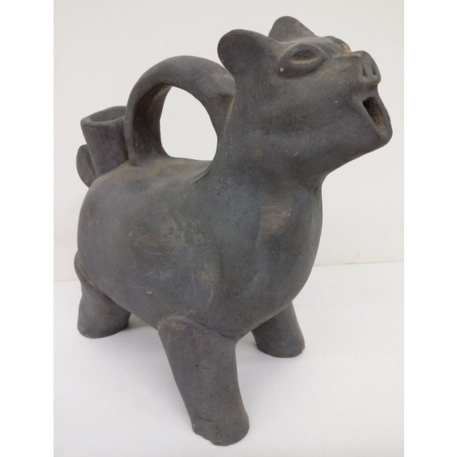 Unique figure of some animal from Chinese mythology. It almost looks like a tea pot because of the open mouth and the hole...