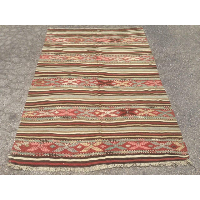 One of a kind hand made vintage Anatolian rug. This gorgeous hand knotted area rug was made in the 1970's by Anatolian...