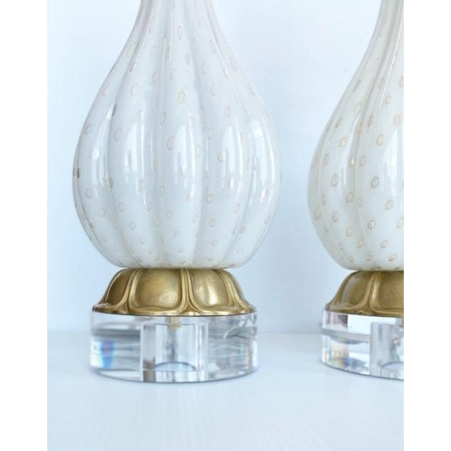 Pair of 1950's Gold Barbini Murano Lamps. New wiring and modern hardware showcase these amazing works of art. Length is to...