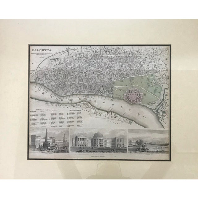 An antique steel engraved map of Calcutta including Fort William, the River Hooghly and the village of Howrah (which...
