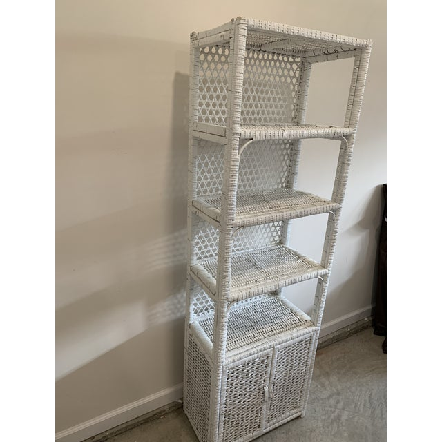 Vintage tall classic white wicker shelf with dual hinged door storage. Has magnetic door latches to assist doors. Very...