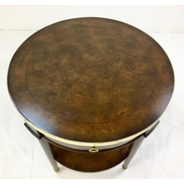 Stylish transitional Mainland-Smith burl occasional table, walnut finish with brass accents, one drawer, one shelf,...