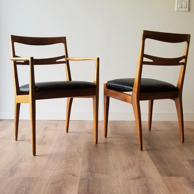 A set of 6 newly upholstered walnut dining chairs designed by Kipp Stewart and Stewart MacDougall for Drexel's Declaration...