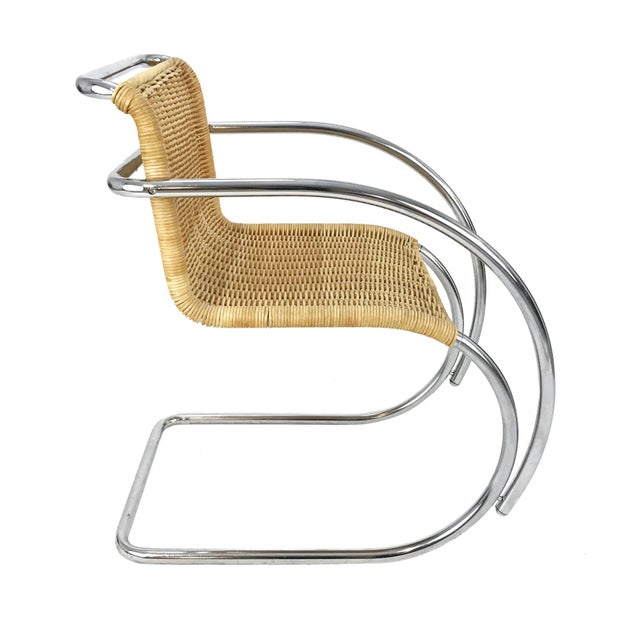 Vintage chrome & wicker armchair, in the style of the MR-20 by Ludwig Mies Van Der Rohe. Wonderful condition. Seat Height:...