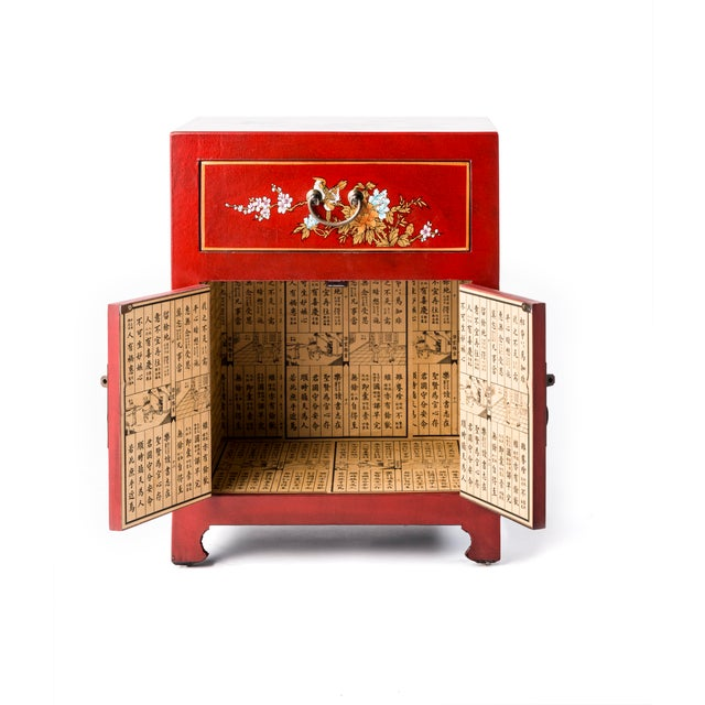 Hand painted floral design on this Chinese Red table, one drawer and two doors , inside decorated with Chinese lettering...